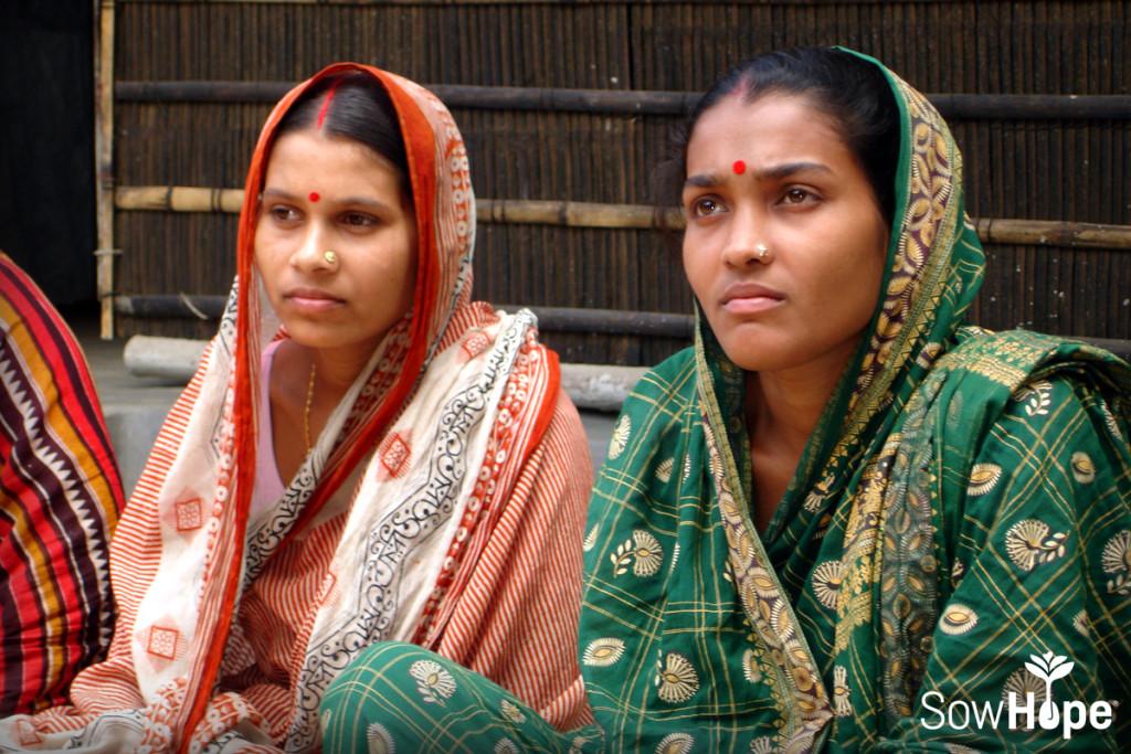 Microfinance women listening.